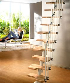 This is the Venus Space saver Staircase Kit with Light Beech treads & White Steel central supporting spine.  This staircase can be installed in a straight flight like this or in a curve.  You'll see more on http://www.staircasekits.co.uk/acatalog/Space_Saver_Staircase_Kits.html