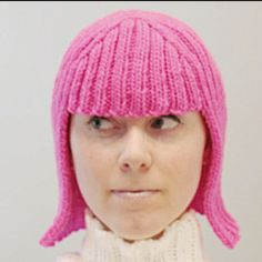 I want one for those winter bad hair days... no, I want two: one in pink and one in green, bright green... and one in blue, bright blue...  Knit wig  http://knitty.com/ISSUEfall04/PATThallowig.html