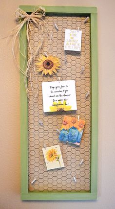 Easy DIY: Create 2 wooden frames with 1x2 boards. Paint frames then attach chicken wire to back frame using a staple gun. Pre drill and then use wood screws to sandwich the frames together with chicken wire in the middle. Hide screws from behind. I used mini clothes pins to attach fun sunflower pics and quotes for a summer decor theme.