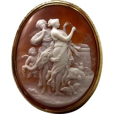 Sardonyx shell cameo brooch depicting goddesses Venus and Diana, c. 1860 Italy