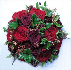 https://flic.kr/p/7rCBxz | Wedding bouquet, winter,reds | Mixed roses, wax flower, skimmia, holly and myrtle