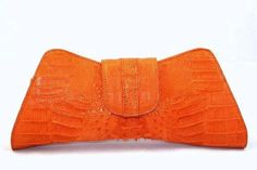 check out this textured orange clutch