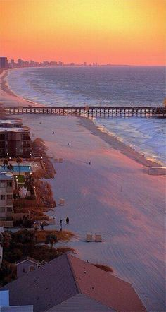 Long Beach, California, sunset coastline over pier and beach.