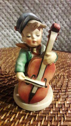 Hey, I found this really awesome Etsy listing at https://www.etsy.com/listing/483314619/m-i-hummel-figurine-sweet-music-186-tmk