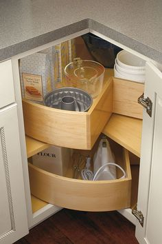 Makes great use of corner space and deep bins provide excellent storage room for large items, such as hand mixers and mixing bowls.