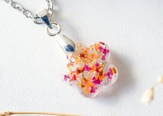 #jewelry #necklaces #charmnecklaces #resin #flowers #queenanne'slace #resinjewelry #resinnecklace #nature #flowerjewelry #pressedflowers #boho #driedflowers #silver #orange #giftsforher jewelry handmade etsy flowers floral pressed flowers resin flower jewelry pressed flower jewelry handmade jewelry necklaces Resin Necklace, Polymer Clay Earrings, Resin Jewelry, Handmade Jewelry, Handmade Items, Jewelry Necklaces, Resin Flowers, Dried Flowers, Beautiful Gift Boxes