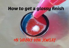 """How to get a glossy surface on shrinky dink jewelry Appears """"fluxe"""" is same as fine embossing powder"""