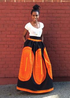 This tangerine maxi skirt is fierce! I'd wear a black blazer and yellow-orange hijab with it.