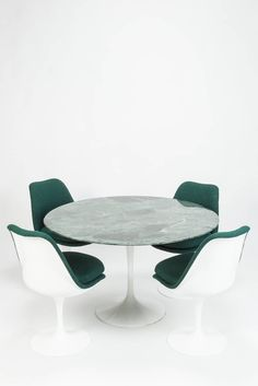 Set of Four Chairs and a Marble Table by Eero Saarinen for Knoll | 1stdibs.com