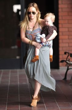Hilary Duff with her adorable son Luca sporting a pair of Minnetonka Velcro Back Flap Booties!