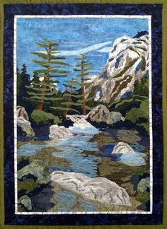 """Mirror Lake, Yosemite, 40 x 29"""", by Lyra W. Bobo. Sections of deep blue lace were used to create shadow and depth in this landscape quilt."""