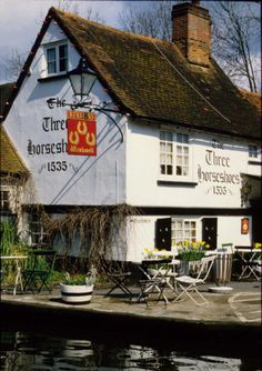 The Three Horseshoes is a traditional 16th-century canalside pub with exposed beams, fireplaces and nook and cranny seating. This pub is in Winkwell, Hemel Hempstead, Hertfordshire, England besides the Grand Union Canal. On a lovely English summer day a cold beer watching the barges go by. It doesn't get much better than this on day out from London.