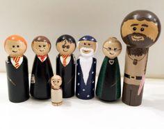 Un ensemble de 9 chevilles : Dumbledore, Harry Potter, Ron Weasley, Hermione Granger, MCGonagall, Hagrid, Rogue, il qui doit être pas nommé et Dobby