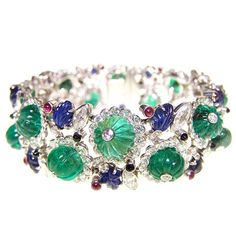 Henri Picq. Important and Rare Fruit Salad Gemstone Bracelet. France. Circa 1925. Photo courtesy Sandra Cronan LTD  An exceptional Tutti Frutti bracelet, set throughout with diamonds, carved emeralds, sapphires, rubies and pointed onyx cabochons. Mounted in platinum. Bearing the maker's mark for Henri Picq. Paris, Circa 1925. Henri Picq was well-known for his beautiful Tutti Frutti jewellery, a great deal of which he made for Cartier.