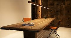 Plank table + acoustic wooden wall. Both made out of bulwark from disused ferry ports. Planke bord, træ væg