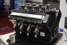 Terinspirasi oleh mesin jet darat - mobil Formula 1, seorang arsitek mesin sekaligus penikmat kopi - Paolo Mastrogiuseppe membuat mesin balap khusus untuk meramu kopi espresso.