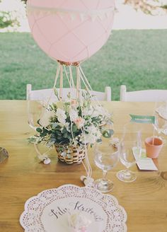 Hot air balloon centerpieces. So, so cute.