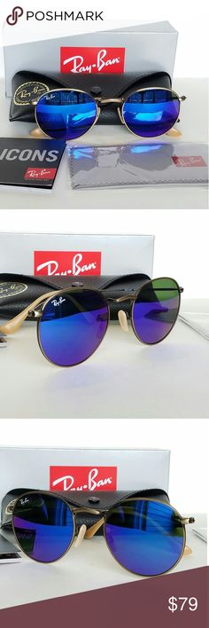 Ray Ban round metal bronze/ Blue Flash 58mm Italy New! Authentic Ray Ban round metal Brushed Bronze/Blue Mirror lenses. mod# rb3447 167/68. Comes with complete Accessories. Box case booklets etc. Ray-Ban Accessories Sunglasses