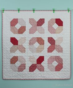 @Audrie Bidwell from Blue is Bleu was able to have this adorable Hugs and Kisses quilt done in 24 hours! Fantastic job! She used a white Aurifil 50wt to quilt it in a grid. To read more visit  http://blueisbleu.blogspot.com/2013/03/hugs-and-kisses-quilt.html