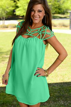 """We're totally caught in the web of this jade gem! The lattice style neckline and flowy skirt are simply AHHHmazing! You will love the way you look and feel in this gorgeous dress! :) Fits true to size. Miranda is wearing the small. All sizes 32"""" in length from shoulder to hem."""