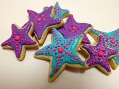 starfish cookies by Danika  for little mermaid party.   My first ever royal icing cookies. I used No Fail Sugar Cookies recipe and two regular star cookie cutters.  After I cut the cookies I moved the raw dough around to give it a more starfish quality.