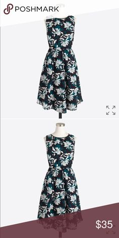 NWT J. Crew flounce dress NWT Gorgeous navy and green flounce dress. Poly. Fitted at waist. Falls above knee. Back zip. Lined. Dry clean. Online exclusive. Accidentally bought 2 so selling this one. No trades. Offers considered. J. Crew Dresses Strapless