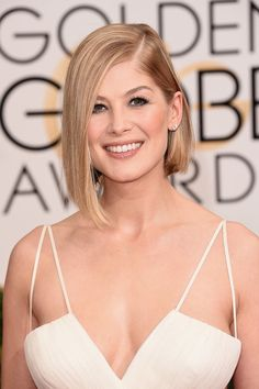 Add some edge to your look with a asymmetrical lob like Rosamund Pike's.