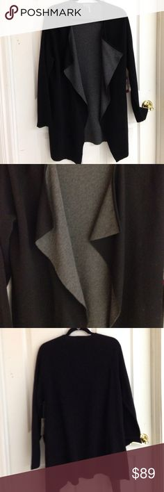 Vince Camuto Long Black and Gray Sweater Vince Camuto long sweater black with gray interior. Flows beautifully! NWT never worn 97% cotton 2% nylon 1% spandex Size M Vince Camuto Sweaters