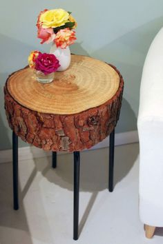 With a little elbow grease, you can upcycle any common end table into a stylish accent piece like this log slice one.