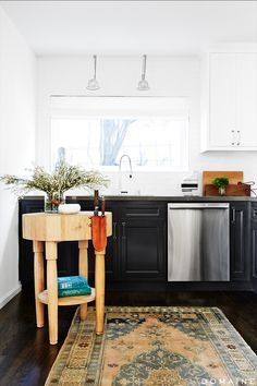 Black and white kitchen with wood table