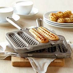 Nordic Ware Waffle Stick Pan Enjoy waffle sticks for breakfast or brunch, dipped into pure maple or sweet fruit syrups – or make dessert versions to dip in chocolate fondue. For a playful appetizer, try savory waffle sticks with your favorite party dips. Cool Kitchen Gadgets, Kitchen Items, Kitchen Tools, Cooking Gadgets, Cooking Tools, Cooking Utensils, Cocina Mickey Mouse, Waffle Sticks, Fluffy Waffles