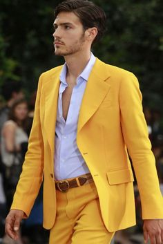 Never thought of dressing a man in yellow...but that looks awesome! :)