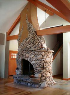 sunny-day-stone-fireplace-design - Home Decorating Trends - Homedit River Rock Fireplaces, Stone Fireplaces, Modern Fireplaces, Natural Building, Green Building, Fireplace Design, Fireplace Hearth, Fireplace Ideas, Mosaic Fireplace