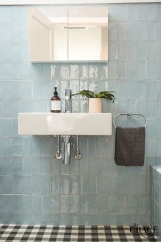 We love the baby blue tiles in this bathroom.