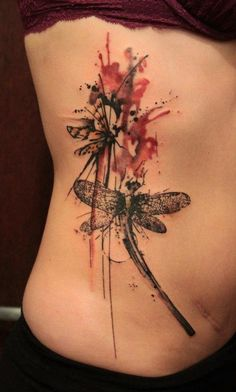 Abstract dragonflies flutter together in this splashy watercolor tattoo by Gene Coffey « « Ratta Tattoo