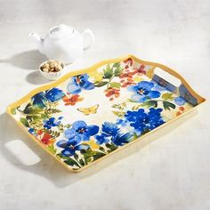 At first glance, you'll think our Butterfly Floral Tray, with its gorgeous detail and yellow-trimmed edges, is crafted of porcelain. But pick it up and you'll discover it's actually made of melamine, which means it's shatter-resistant and perfect for outdoor use.