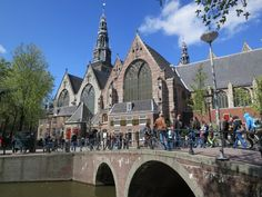"Amsterdam's Oude Kerk (""old church"", built in 1300) is situated in the heart of the Red Light District. The floor of the Oude Kerk consists entirely of gravestones (among them the wife of Rembrandt) and the roof is the largest medieval wooden vault in Europe."