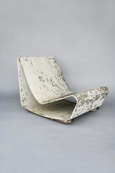 Swiss Willy Guhl conceived 'Loop Chair', an outdoor furniture piece handmade from eternit, a fibre cement, 1954