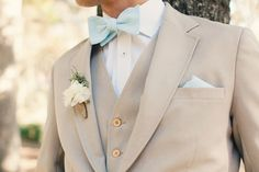 tan suit with a teal seersucker bow tie | Riverland Studios