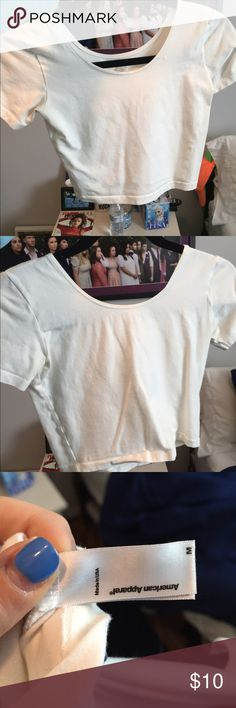 White Cotton Spandex Jersey Crop Tee! This is a white crop top from American Apparel! It has been worn once or twice and is very tight fitting. I think it looks great with high waisted jeans or shorts! *Offers accepted!* American Apparel Tops Crop Tops
