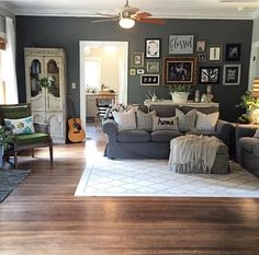 Anxious to update our fans to something more my style! Buffet, cupboard, and green chair are all thrift store finds! Wall Color: Benjamin Moore Kendall Charcoal, Grey Couch & Loveseat: Ikea Ektorp, #1911cottagerenovation #gallerywall #songbirdandco