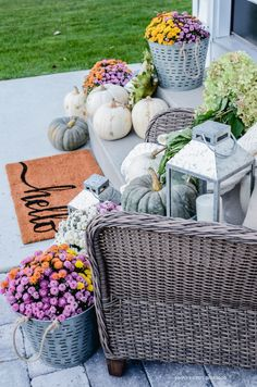 Create a simple fall porch in no time! Pumpkins, mums, lanterns, cozy throw, wicker chair...come see how to put them all together easily and quickly.
