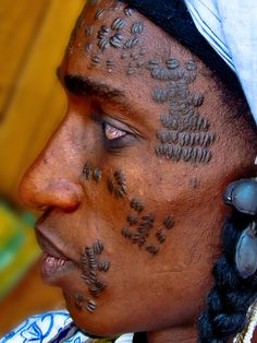 Africa | 'Hanagamba'  The scarification  of a nomadic Fulani. Central African Republic. | © AfricanButterfly, via Flickr