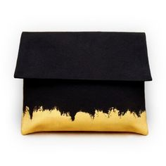gorgeous clutch purse in black + gold