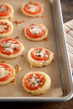 Paula Deen Tomato Tarts: 1 pound bulk sausage (hot, sweet, or breakfast sausage), crumbled  3 cups baking mix (recommended: Bisquick)  2 cups (1/2 pound) grated Cheddar  24 grape tomatoes, halved