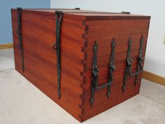 reproduction chest with hand cut dovetail joints and hand forged hardware. I blacksmithed the hardware at fort york and built the chest while i was in college when i was 19