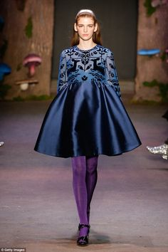 Pure drama: Honor's fashion show featured a midnight blue empire-waist dress ...