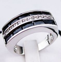 GORGEOUS SPARKLING 10KT WHITE GOLD FILLED RING     Metal: 10KT white Gold Filled   MAIN GEMSTONE : Black Sapphire   ring WEIGHT(CT):9G   ring size(approx):10   mian stone size :5*2mm
