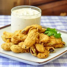These deep fried pickles were inspired by those found at the Penguin Diner in Charlotte, with a warmly spiced, crispy batter & a creamy chipotle ranch dip.