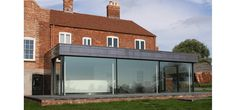 IQ Glass UK designed and installed oversized glass sliding doors to a contemporary rear extension in Worcestershire.